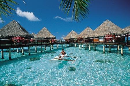 tahiti-village-man.boat.jpg