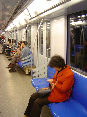 shanghai-red.woman.in.cart-metro.line.three.jpg.jpg